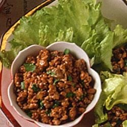 Easy Lettuce Wraps Recipe - Lettuce leaves are great wraps for stir-fried pork. This fun recipe is bursting with Asian flavors!