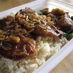 Rubbed Down Pork Chops Recipe - Pork chops rubbed down with minced garlic, garlic powder, salt, and pepper are cooked in Worcestershire sauce and water with onions and mushrooms.