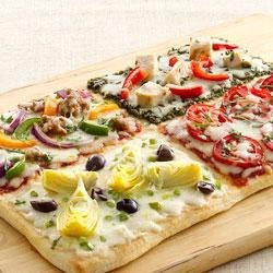 4-Square Family Pizza Recipe - Let your family's creativity run wild with this fun pizza that features four different delicious topping portions.