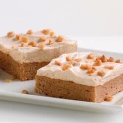 Spiced Pudding Squares Recipe - Spice cake gets a fluffy spiced topping and a sprinkle of toffee bits for an easy dessert with delicious fall flavors.