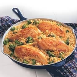 Campbell's(R) 15-Minute Chicken and Rice Dinner Recipe - Chicken, broccoli and rice in a creamy gravy are the stars in this easy skillet supper.