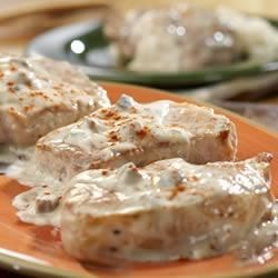 Creamy Ranch Pork Chops and Rice Recipe - A star is born when a favorite herbed salad dressing mix gives new life to this classic mushroom-sauced pork chop skillet. It's easy and your family will love it served with ranch-flavored rice.