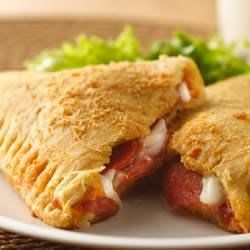 Crescent Pizza Pockets Recipe - Make perfect pizza pockets by wrapping pizza sauce, mozzarella, and pepperoni in crescent dough and baking until golden brown.