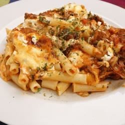 Baked Ziti III Recipe - Layers of ziti pasta, beefy tomato sauce, sour cream and Italian cheeses get a final dash of flavor with a generous sprinkling of chopped fresh basil before baking.