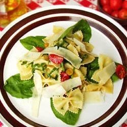 Pasta Carcione Recipe - This easy pasta dish is very colorful and features the creamy tart flavor of goat cheese. Juicy red tomatoes and thin strips of garden-fresh spinach are tossed with hot farfalle and olive oil. Crumble goat cheese over the top and serve warm.