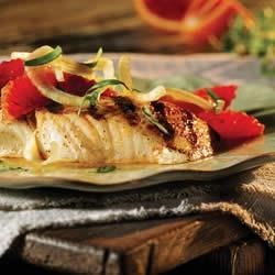 Grilled Halibut with Fennel and Orange Recipe - Fresh halibut fillets get the royal treatment with a citrus marinade, a quick grilling, and a topping of orange and fennel slices.