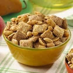 Double Peanut Snack Mix Recipe - This easy snack made with cereal squares and JIF(R) Peanut Butter is sure to satisfy anyone's sweet tooth. A great munchie for a movie night!
