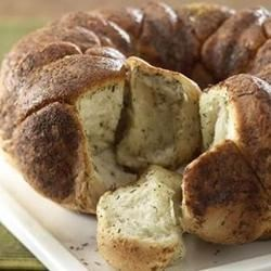 Herbed Pull Apart Bread Recipe - Using frozen roll dough, you've got savory pull-apart bread fragrant with herbs and cheese with little prep time.