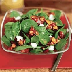 Almond Spinach Salad Recipe - The crunch of candied California Almonds is combined with goat cheese, baby spinach and a tangy vinaigrette to make this fresh-tasting salad.