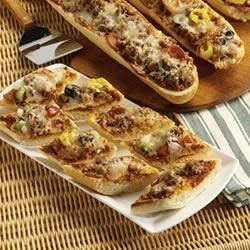 Sausage French Bread Pizza Recipe - Once your guests smell this sausage and cheese pizza coming out of the oven, nobody will be able to resist.