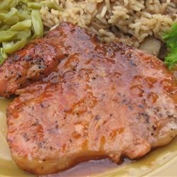 Spicy Pork Chops Recipe - Spicy tomato sauce easily livens up plain old pork chops.