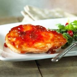 Cranberry Glazed Chicken Recipe - Don't limit cranberry sauce to holiday turkey dinners. Blend it with Heinz ketchup and a hint of spice to make a delicious sauce for tender chicken breasts. Serve with creamy mashed potatoes and steamed green beans on the side to complete the meal.