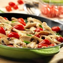 Chicken with Grape Tomatoes and Mushrooms Recipe - Here's a way to get great flavor, fast. This quick-cooking skillet dish features strips of sauteed chicken with mushrooms, green onions and grape tomatoes.