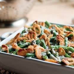 Campbell's(R) Green Bean Casserole Recipe and Video - This traditional casserole made with cut green beans, cream of mushroom soup, and French fried onions is the perfect addition to your holiday table.