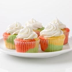 Tie-Dye Fruity Cupcakes Recipe - Yellow, green, and red-swirled cupcakes make dessert a party!