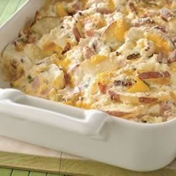 BREAKSTONE'S Sour Cream Scalloped Potatoes Recipe - Two kinds of cheese, sour cream and green onions make these scalloped potatoes with ham a quick, creamy side dish for a large crowd.
