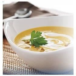 Creamy Sweet Potato Soup Recipe - This aromatic sweet potato soup gets its velvety creaminess from yogurt and a little crunch from a sprinkle of pumpkin seeds.