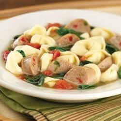 Sweet Italian Chicken Sausage and Tortellini Soup Recipe - Italian chicken sausage is simmered with wine, broth, tomatoes, spinach and tortellini for this hearty, Italian-inspired favorite.