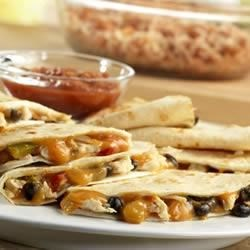 Campbell's Kitchen Chicken and Black Bean Quesadillas Recipe - Cheese sauce, chicken, black beans and salsa are folded inside flour tortillas and baked until tortillas are crisp: A new family-favorite dish is born!