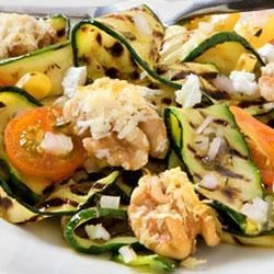 Grilled Zucchini Salad with Pizza Walnuts Recipe - Long, elegantly thin slices of summery zucchini marinate in the garlicky dressing to make a simple and delicious salad.