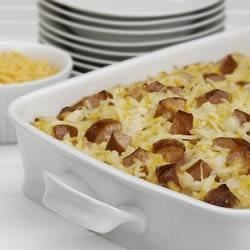 Cheesy Potatoes with Smoked Sausage Recipe - Meat and Potatoes, a time-tested, delicious combination that everyone loves. Hillshire Farm(R) Smoked Sausage with potatoes and melted cheese served with sour cream and onion. In other words: delicious.