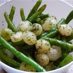 Green Beans with Caramelized Onions Recipe - Pearl onions are caramelized, then quickly sauteed with green beans. The combination of flavors is what makes this dish a hit!