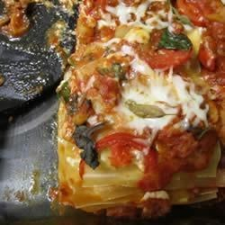 Sausage and Garden Veggie Lasagna Recipe - Fresh peppers, mushrooms, chard, and basil bring bright flavors to this Italian sausage lasagna.