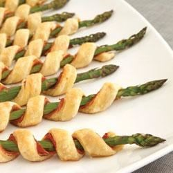 Prosciutto Asparagus Spirals Recipe - Easy to prepare, but oh so elegant . . . these tempting appetizers feature asparagus spears individually wrapped with prosciutto, garlic & herb cheese and flaky puff pastry.