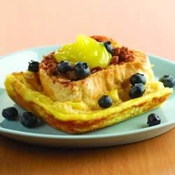 Lemon Cream Stuffed French Toast with Streusel Topper and Fresh Blueberries Recipe - Slices of French bread are layered with a creamy lemon filling and baked into a tasty French toast casserole with a crunchy oat topping.