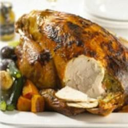 Glazed Turkey with Maille(R) Honey Dijon Mustard Recipe - This roast turkey is filled with a flavorful stuffing of bacon, Dijon mustard, apricots, onions, and breadcrumbs and roasted with root vegetables, celery, and zucchini. It's an elegant and satisfying meal for Thanksgiving, or any special occasion.