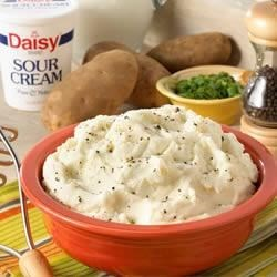 Garlic and Herb Mashed Potatoes Recipe - Ordinary mashed potatoes get the royal treatment with the addition of fresh herbs, garlic and Daisy Brand Light Sour Cream.