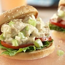 Picnic Chicken Salad Sandwiches Recipe - Cream of celery soup is the secret ingredient that makes this chicken salad creamy and flavorful...served on sesame seed sandwich buns, these sandwiches can be put together in just 15 minutes.