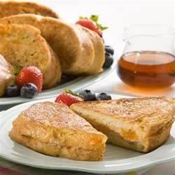 McCormick(R) Stuffed French Toast Recipe - French toast stuffed with sweet cinnamon-spiced cream cheese and apricot preserves is the perfect brunch dish to greet your family on a weekend morning.