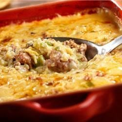 Hot Sausage Casserole Recipe - This sausage and rice casserole is seasoned with onions, green peppers and a creamy sauce . . . when you're in the mood for something especially tasty, give this dish a try!