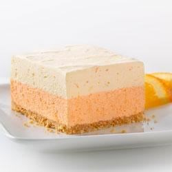 Orange Dream Layered Squares Recipe - Two layers of orange creaminess on top of a graham cracker crust make a bright and refreshing dessert.