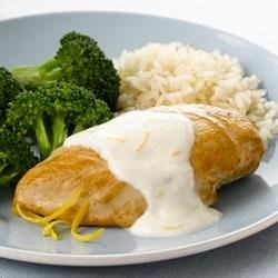 Chicken with Creamy Lemon Sauce and Rice Recipe - This easy weeknight dinner with chicken and broccoli is served over hot cooked rice with a creamy lemon sauce.