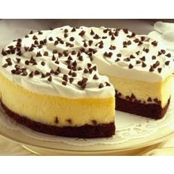 Brownie Chocolate Chip Cheesecake Recipe - A cream cheese filling tops a crust of chewy chocolate fudge brownies. Garnish with mini chocolate chips.