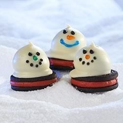 Melting Snowmen OREO Cookie Balls Recipe - Cold weather got you down? Bring the outdoors in with these cool confections, sure to make a winter lover out of everyone.