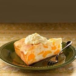 Pretty Peach Cake with Pineapple Frosting Recipe - Pineapple cream cheese topping turns this moist peach cake into a special-occasion treat.