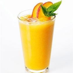 Dannon Sunshine Smoothie Recipe - Start the day with a glassful of sunny fruit--mango, banana, orange juice and tangy yogurt fuel a busy day.