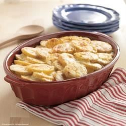 Creamy Scalloped Potatoes by Daisy Brand Recipe - Comfort food at its creamiest, these scalloped potatoes are baked with a creamy, cheesy sauce, topped with paprika, and baked until bubbly and browned.