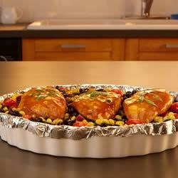 Southwest Chipotle Chicken Recipe - Chicken breasts, black beans, corn, and grape tomatoes are baked with a chipotle marinade in this one-pan dinner with a Southwest flair.