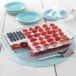 Wave Your Flag Cake Recipe - This all-American flag cake is delicious and easy to assemble.  A pound cake and gelatin base is frosted with whipped topping and decorated with blueberries and strawberries.