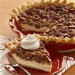 Vanilla Pecan Pie Recipe - Cheesecake meets pecan pie in this smooth and decadent seasonal dessert.