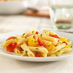 Mini Penne with Sweet Peppers and Parmigiano-Reggiano Recipe - Mini penne tossed with colorful bell peppers and fresh basil makes a colorful and satisfying vegetarian meal. Barilla White Fiber pasta adds a healthy fiber boost without sacrificing taste.