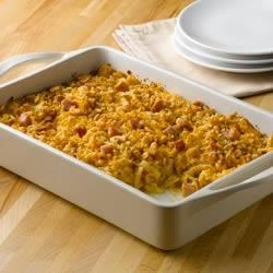 Southwestern Ham and Cheese Party Potatoes Recipe - This cheesy ham and potato casserole is a perfect recipe to make when serving a crowd. If you are headed to a party just bake and take.
