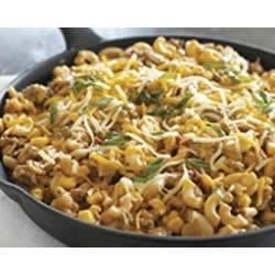 One-Pot Salsa Beef Skillet Recipe - Macaroni and cheese goes Tex Mex with the addition of ground beef, salsa, corn, and shredded cheese.