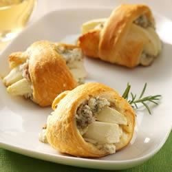 Apple-Rosemary Blue Cheese Bites Recipe - Make a savory and sweet appetizer by baking flaky, crescent triangles rolled up with blue cheese-pecan spread and apples.