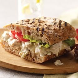 Caesar-Chicken Salad Panini Recipe - Creamy chicken salad with lemon and Parmesan cheese is sandwiched between whole grain bread slices and grilled until golden brown.