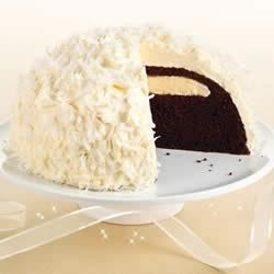 Snowball Cake Recipe - A grown-up version of the classic lunchbox treat, this cake will bring back memories and bring up the question we all had as kids: how did the cream filling get in there?